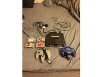 Nintendo 64 with 2 controllers and 4 games