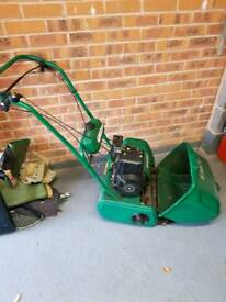 Petrol lawn mower and strimmer