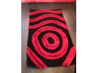2 brand new red / black rugs