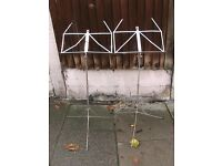Two silver folding music stands