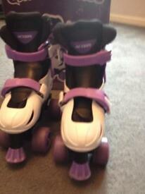 Purple and white roller skates size 11-13.