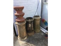 Pre 1900s chimney pots with modern cowls