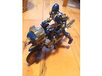 Action figure on motor bike.