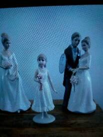Leonardo figurines of Bride & Groom , Maid of Honour and Flower Girl.