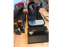Red Nespresso Citiz Magi Mix Coffee Machine with coffee pods