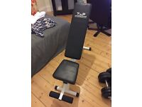 Adjustable weights bench with 30kg of weights, also comes with protein
