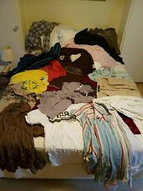 Large number shirts and several jackets.