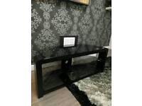 Universal black glass tv table