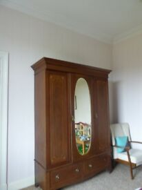 Mahogany Edwardian wardrobe with marquetry and oval mirror