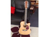 12 strings acoustic guitar with no marks and new.