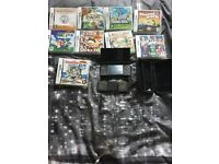 Nintendo DSI with case, charger and games