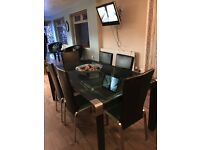 Selling glass table with 6 black leather chairs