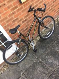 Mountain bike. Good condition. Along with a brand new bike helmet and Deliveroo riding kit.