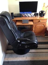 PlayStation 4 entertainment system including desk and gaming chair
