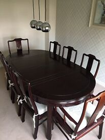 Extendable dining room table with 8 chairs