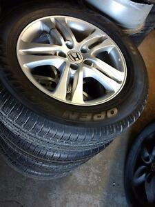 215 70 16 / 225 65 17 tires / OEM Honda CRV alloy and steel rims 5 x 114.3 in stock