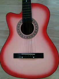 HASGUITARS/ RHINO Acoustic Guitar in very good condition.
