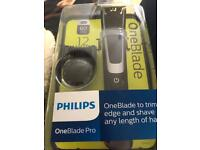New out Philips one blade pro with 12 length comb