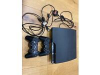 SONY PLAYSTATION 3 SLIM PLUS 2 CONTROLS