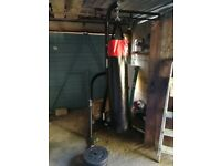 Freestanding punch bag stand with bag. Various assorted weights. Abs roller. And sit up bench.