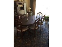 Excellent Condition dining room table complete with 6 wooden and fabric chairs