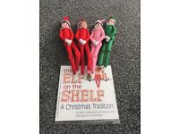 Christmas elf on a shelf dolls and books