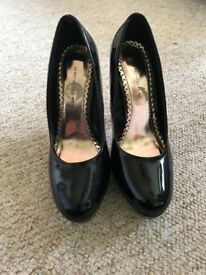 Brand new black high heeled shoes size 5