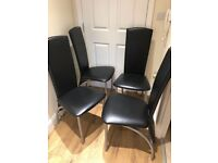 4 x black and silver faux leather dining chairs