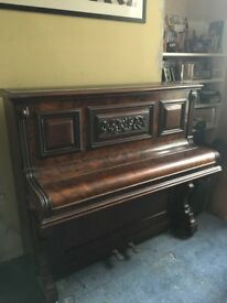 Upright piano dating from 1880s- beautiful, decorative case, interior in poor state of repair.