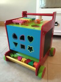 Push along shape sorter