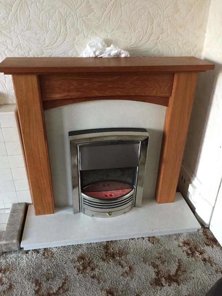 Oak fire surround marble hearth and electric fire