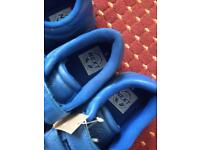 Two pairs of kids blue shoes