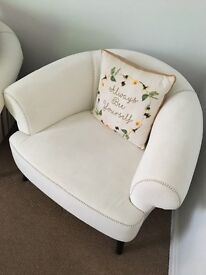 Beautiful designer sofa in white fabric with striped back design ( very eye catching)
