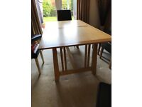 Oak dining table and seven chairs