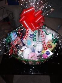 CHRISTMAS HAMPER WITH VARIOUS TOILETRIES IN BASKET GIFT WRAPPED