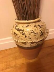 Terracotta pot with twigs