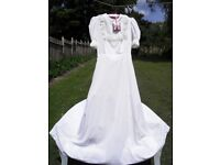 Wonderful white Wedding dress handmade with built in petticoats vail also available if wanted