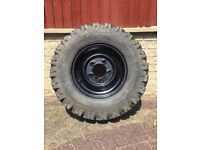 Deestone 7.5/16 8 ply All Terrain tyre on black steel rim. Extra traction tyre