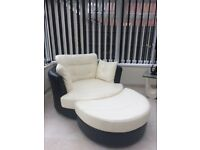 Round swivel black and cream leather chair with matching footstool