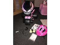 Battery girls pink motorbike with helmet in excellent working condition