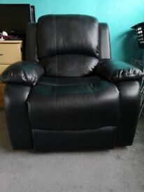 Black faux leather reclining chairs and sofa