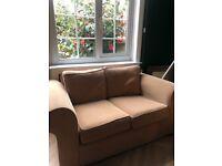Small double tan sofa