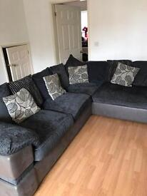 Grey fabric corner sofa with double ved