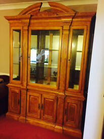 A Wooden Glass Cabinet