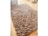Large sparkle rug. Nearly new. Beige.