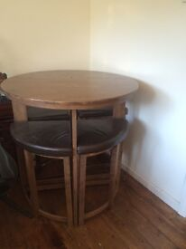 Stylish Round wooden dining table with four chairs