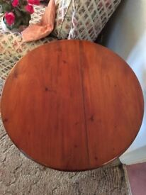 Round wooden table with centre leg
