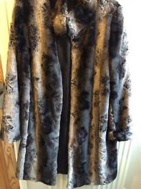 Stunning faux fur coat size 14/16 new!