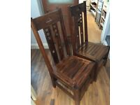 Pair of solid wood dining chairs