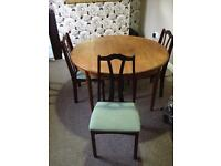 Extendable Diningroom Table with 3 Chairs